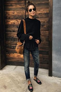 black crew neck sweater cuffed skinny jeans embroidered loafers