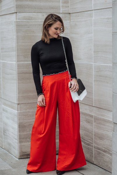 black cropped sweater with red wide leg pants