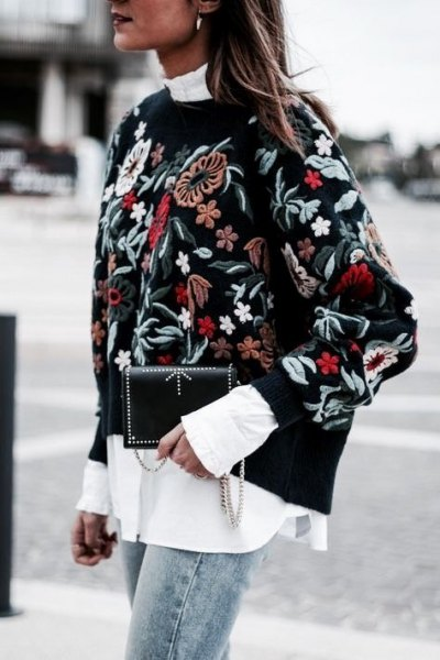 black embroidered sweater over white mock neck shirt