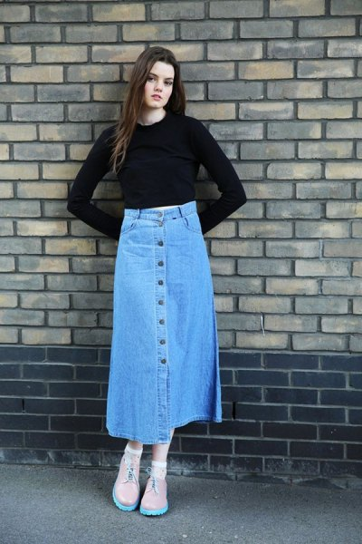 black form fitting cropped knit sweater with blue button front skirt