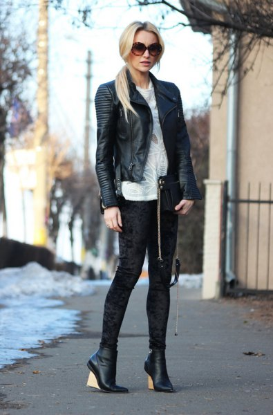 black leather blazer with white sweater velvet leggings