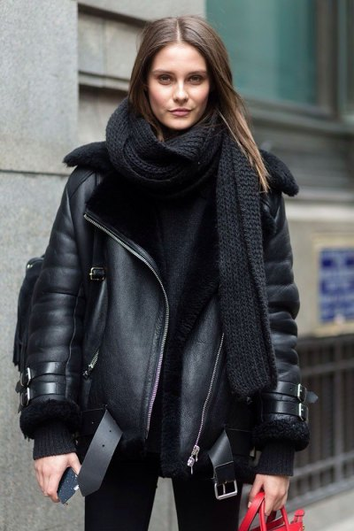black leather coat with scarf and knit sweater