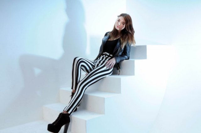 black leather jacket striped leggings heeled boots