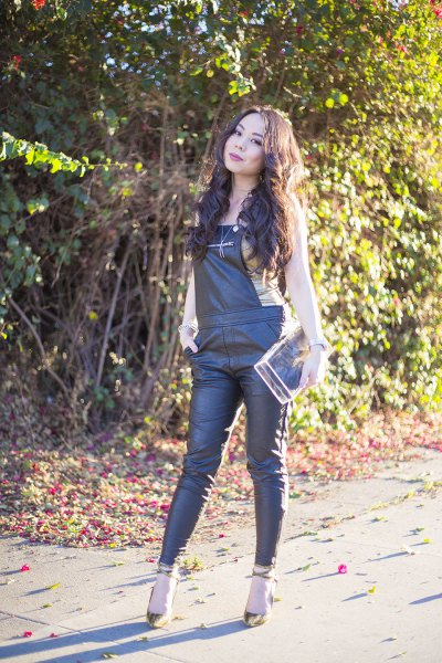 black leather overalls with pale pink sleeveless top
