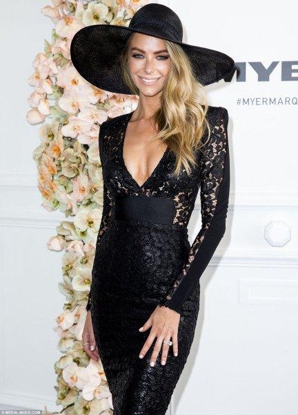 black long sleeve bodycon midi dress with big floppy hat
