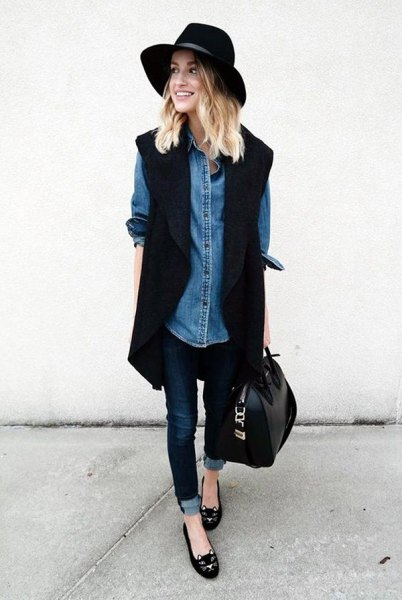 black long sleeveless blazer with chambray shirt and felt hat