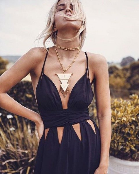 black low cut spaghetti strap maxi flared dress with long statement necklace