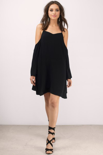 black mini swing dress with gladiator heels