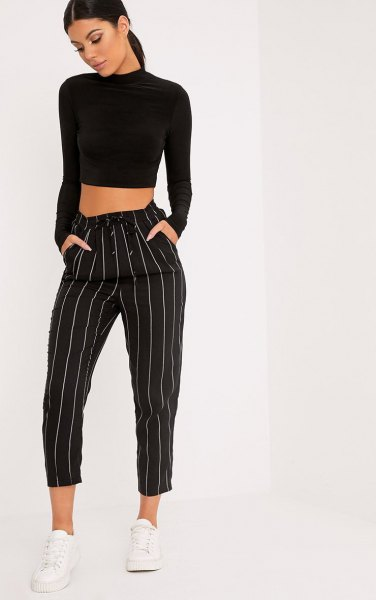 black mock neck cropped sweater with striped cropped wide leg trousers