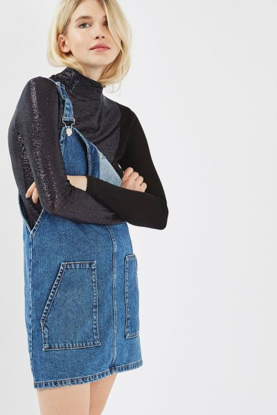 black mock neck glitter long sleeve top with blue denim pinafore dress
