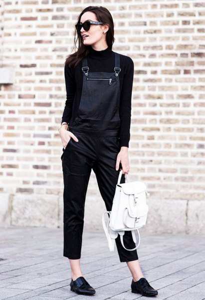 black mock neck knit sweater with leather overalls