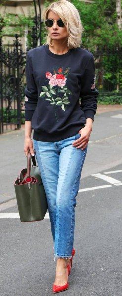 black rose embroidered sweatshirt with blue jeans