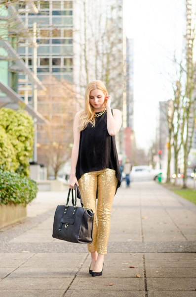 black sleeveless blouse gold sequin leggings chain necklace