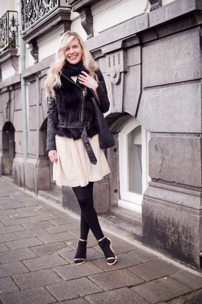 black velvet shearling jacket with pale pink chiffon flared mini dress