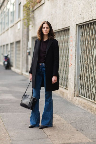 blue flared jeans with black long wool coat