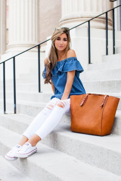 blue off the shoulder denim top with white skinny jeans and sneakers
