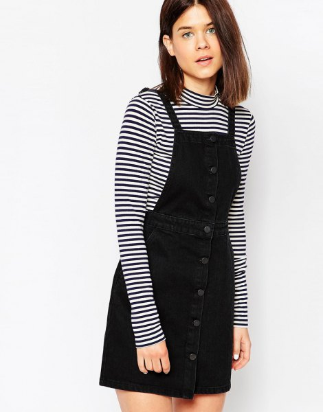 button front pinafore dress with black and white striped long sleeve tee