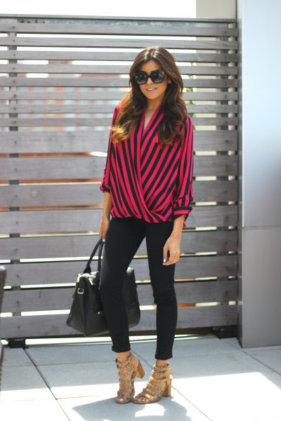 green and black striped wrap blouse and black skinny jeans