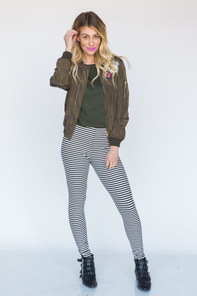 green bomber jacket narrow striped leggings boots