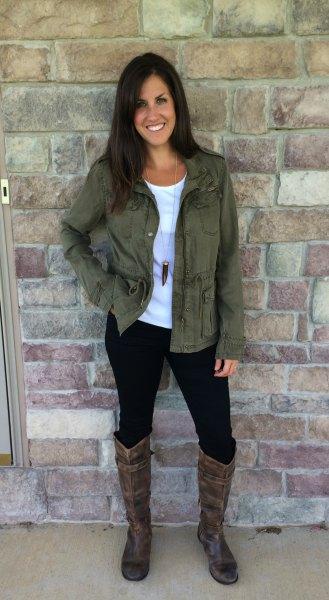 green jacket black skinny jeans knee high boots