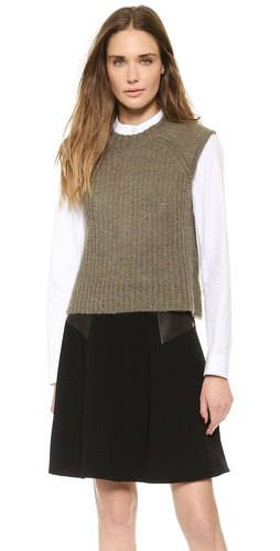 green ribbed sweater vest black flared mini skirt