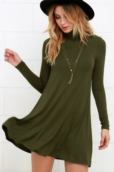 green swing dress with boho style necklace