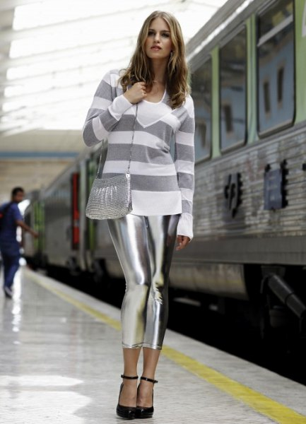 grey and white wide striped sweater with metallic leggings