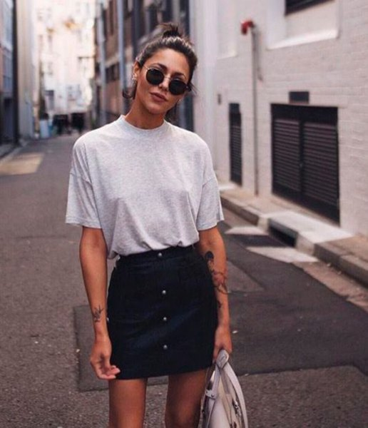 grey t shirt with black denim button front mini skirt