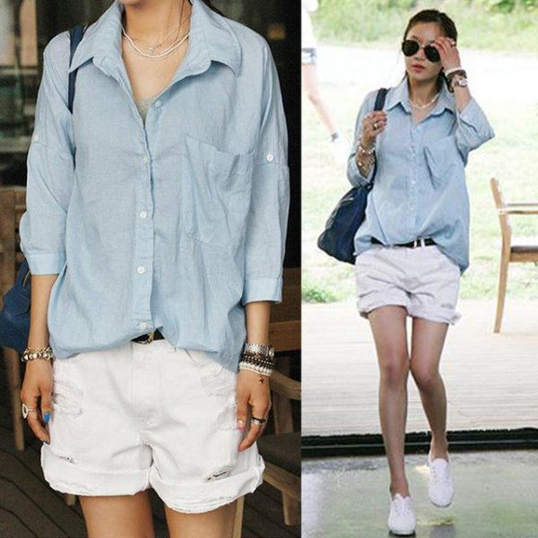 greyish blue button up shirt cuffed white denim shorts