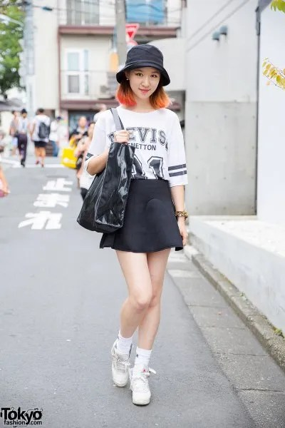 leather bucket hat with white print tee and black mini skater skirt