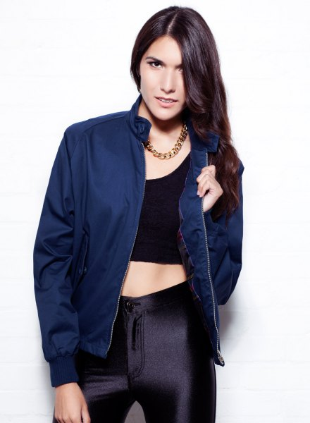 navy jacket with black crop top and silk skinny pants