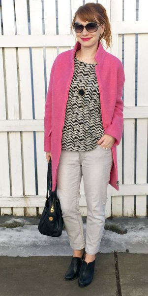 neon pink coat black and white patterned sweatshirt