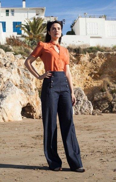 orange key hold blouse with dark blue wide leg sailor pants