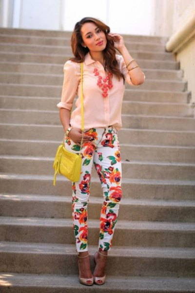 pale yellow button up shirt with pink open toe heels
