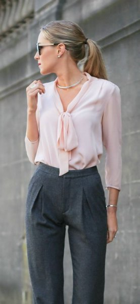 pink bow neck blouse with grey wool pants silver choker