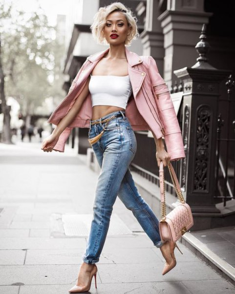 pink leather coat with white crop top jeans