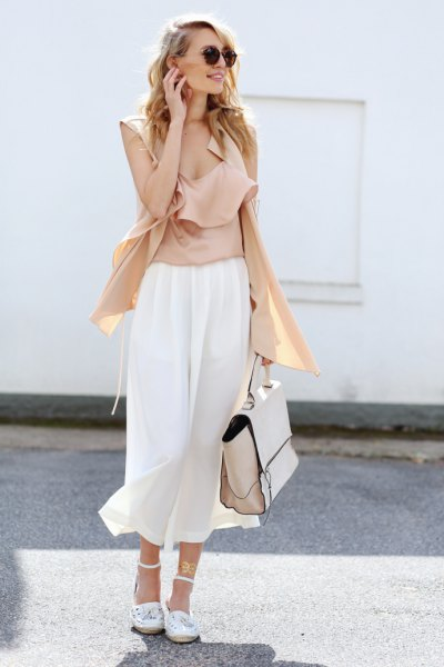pink scoop neck sleeveless blouse with white culottes