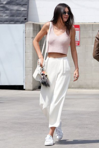 pink sleeveless cropped ribbed sweater with white culottes