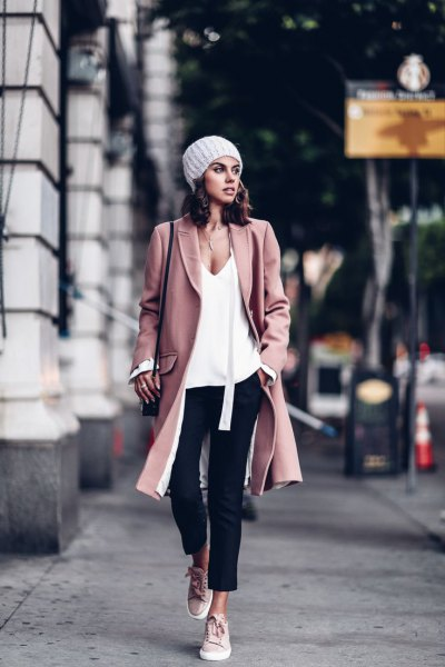 pink wool coat white deep v neck vest top black jeans