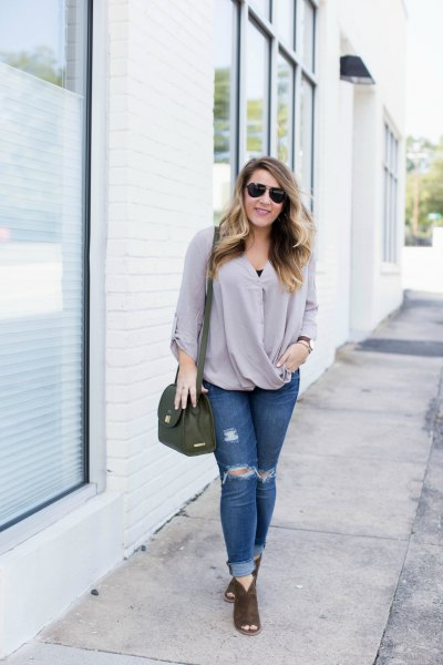 pink wrap blouse with ripped skinny jeans