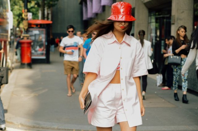 red leather bucket hat with pale pink oversized shirt and shorts