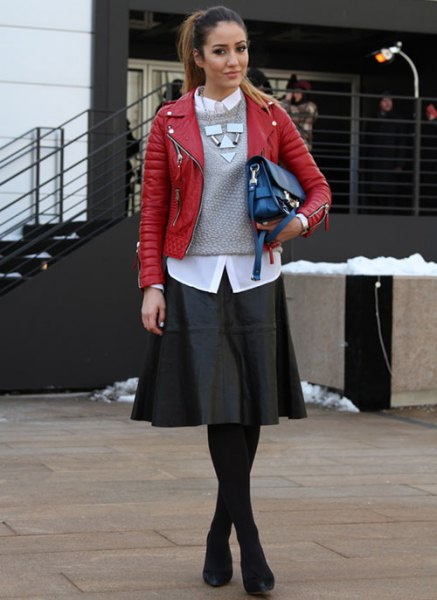 red leather jacket with grey knit sweater and black skater dress