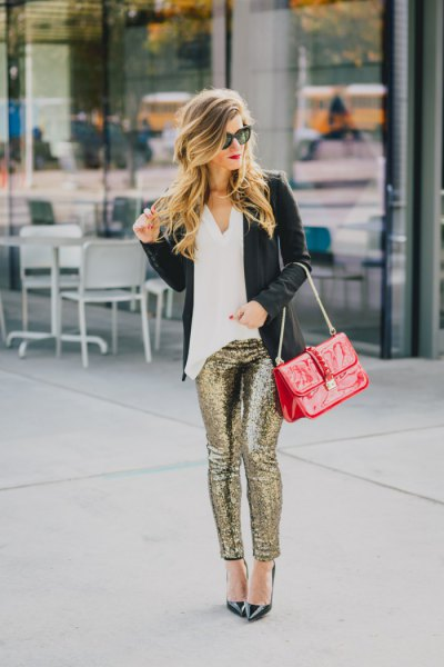 white blouse black blazer with gold sequin leggings