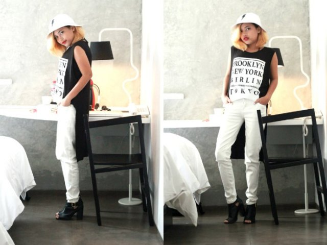 white bucket hat with black sleeveless high low top jeans