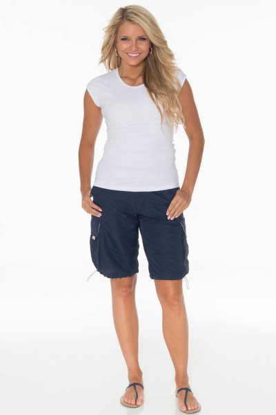 white cap sleeve tee navy long cargo shorts