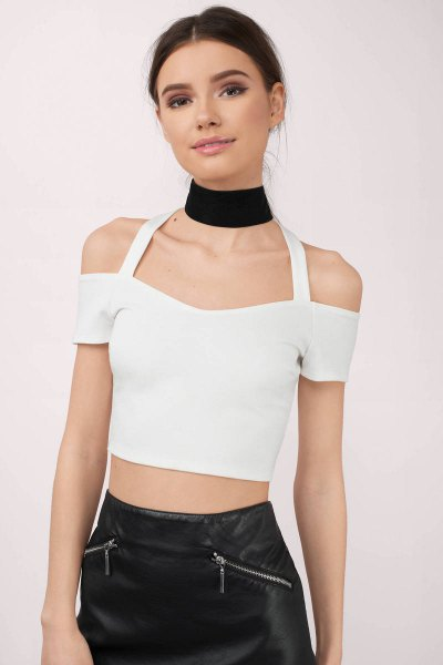 white cold shoulder crop top black leather skirt