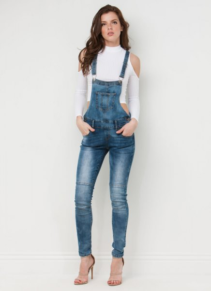 white cropped cold shoulder sweater with blue denim skinny overall
