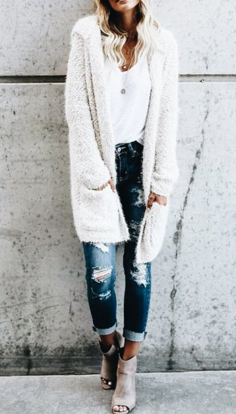 white fuzzy longline hooded cardigan with ripped skinny jeans