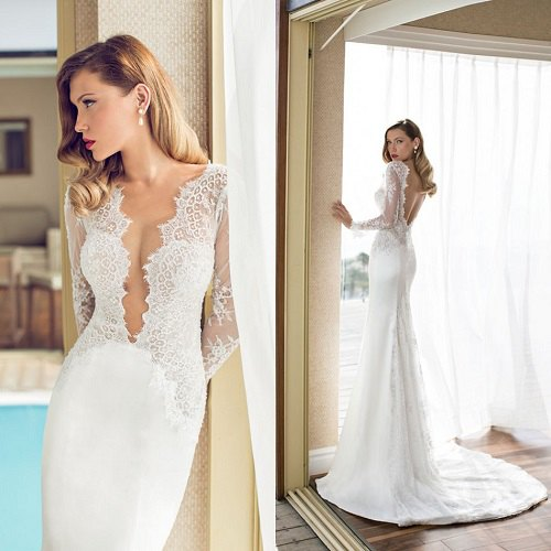 white lace plunging neckline flowy wedding dress