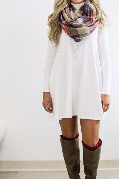 white long sleeve swing dress with crepe and navy plaid scarf